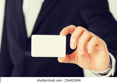 business, office, advertisement concept - businessman showing blank card