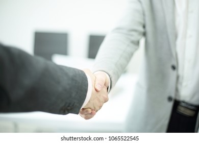 business and office concept - businessman shaking hands