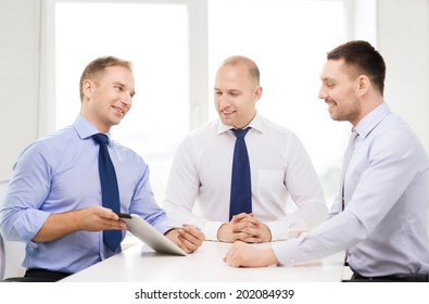 business and office concept - smiling business team working with tablet pc computer in office