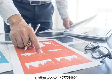 Business, office concept. Working process, Man discussing with financial document.