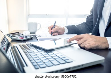 Business, office concept. Working process, Man writing on note paper with color pen.