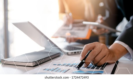 Business and office concept,Team businessman working monograph with laptop and clipboard on white desk,Interior office blurred background.- Image