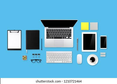 business office desk with workspace, cell phone, tablet, coffee cup, notebook, pencil, on blue pastel background