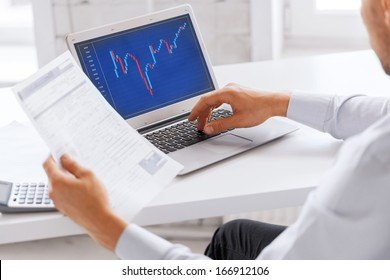business, office and money concept - businessman working with forex chart and papers in office