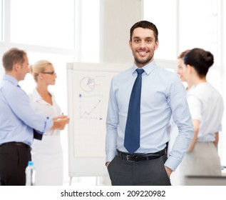 business, office and people concept - group of smiling businessmen with smartboard in office