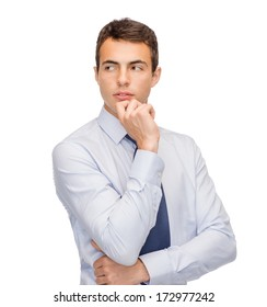 business and office, people concept - pensive young buisnessman