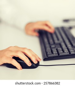 business, office, school and education concept - woman hands with keyboard and mouse