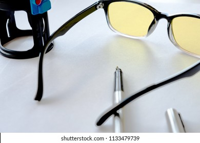 for business in the office set that includes glasses and a stamp on the print, white background