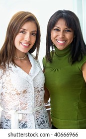 Business office team work - young and successful businesswomen