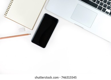 Business office work desk table with computer laptop , note and stationery on white table background include copyspace for add text or graphic