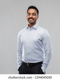 business, office worker and people concept - smiling indian businessman in shirt over grey background