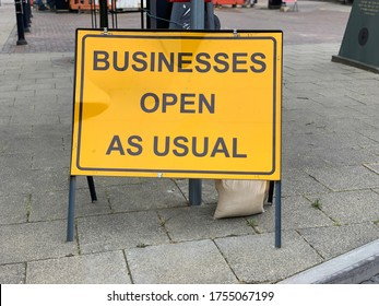 Business open as usual sign signifying easing of lockdown
