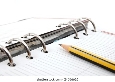 business organizer on white background with pen