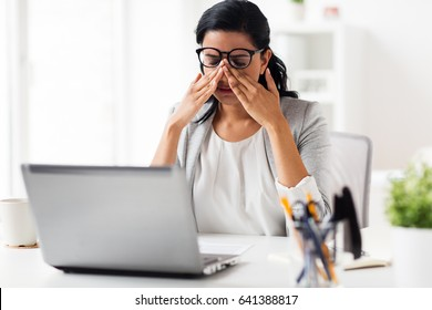 business, overwork, deadline, vision and people concept - tired businesswoman in glasses working at office and rubbing eyes