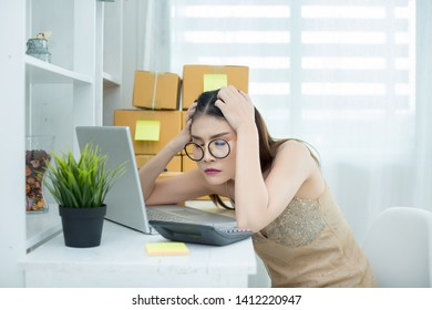 business owner working at home office packaging on background