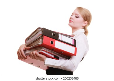 Business and paperwork. Tired overworked busy businesswoman carrying stack of folders with files documents isolated on white.
