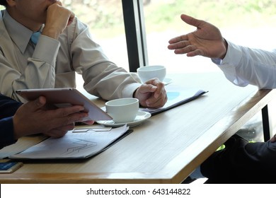 Business partner discussing hand pointing at business documents and  idea at meeting