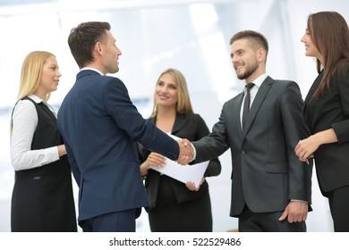 Business partner greeting each other with handshake