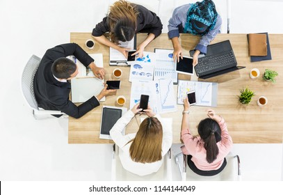 Business Partner or Investor or Entrepreneur Meeting Conference Discussion Corporate Using Digital Device Connection. Friendly coworkers working together. Technology Meeting Teamwork Concept