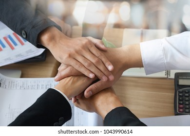 business partner marketing team discussing market research and brainstorming with colleagues in a meeting. professionals having a meeting in conference room looking at documents or excel