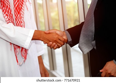 Business partners concept : Partnering with foreign business partners : Collaboration between foreign business partners (Arabian nationals) ) With Asian businessmen