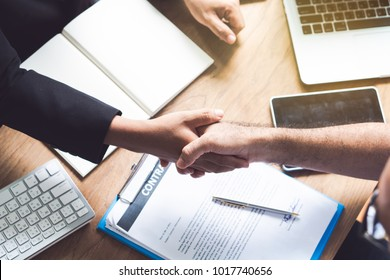 Business partners confirm corporation. Young startup businessman shaking hands with Supplier / client after agree a deal to collaborate for to order supply for his plant.