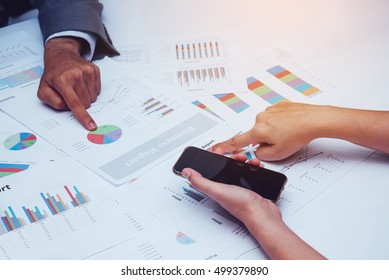 Business Partners Discuss about Business with Documents Report