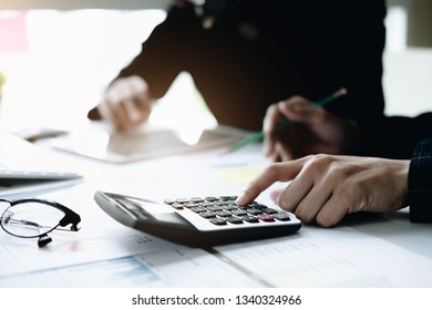 Business and partners discussing new plans marketing financial graph data on office table with using calculator in meeting