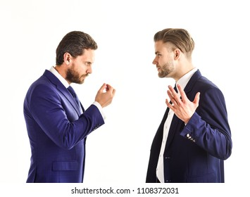 Business partners discussing problems isolated on white background. Men in suits or businessmen with tense faces and hands expression speaking. Business misunderstanding concept.