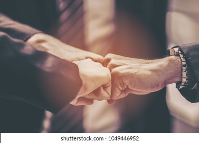 Business Partners Giving Fist Bump to Greeting Start up new project or complete mission successful deal together with strong teamwork.Business partnership start up concept.Merger, acquisition concepts