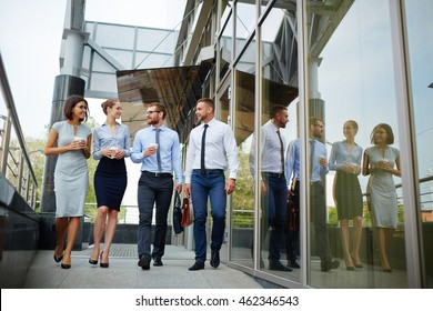 Business partners go to work together after coffee break