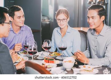Business Partners Having Dinner in Restaurant