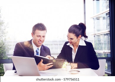 Business partners having meeting at office, smiling, busy by work.