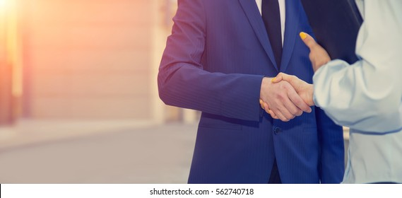 Business partners, man and woman handshake. Business concept. New team members.