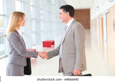 Business partners meeting in modern building