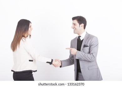 business partners shaking hands. studio shot on a white background.