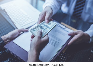 business partners signing contract to borrow money from investor to invest at own business