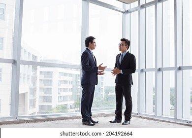Business partners talking inside the building under construction