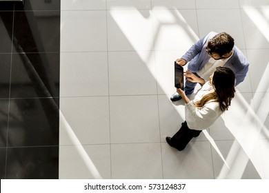 Business partners talking in modern office, view from above