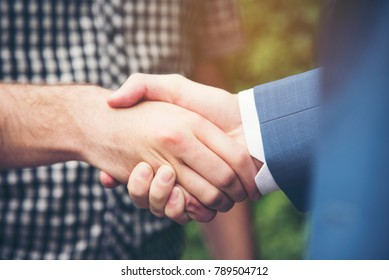 Business Partners Team meeting  holding hand together as a Team Building. Successful Teamwork Hands Gesture. Partnership Business Concept.