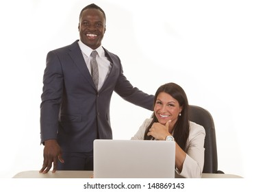 Business partners working together with smiles on their faces.