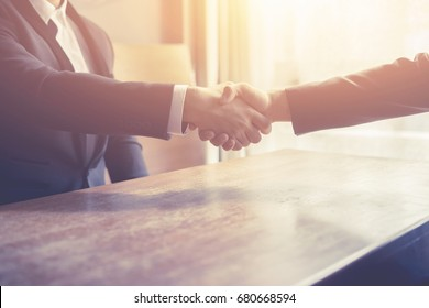 Business partners,Great job,Sealing deal,Successful business,Handshake,Businessman join together,Good agreement.two business people shaking hands standing at work place,Vintage color