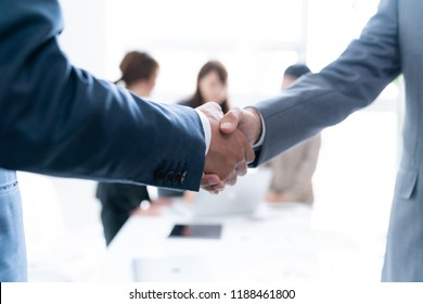 Business partnership concept. Shaking hands.