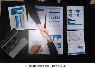 Business partnership consult and meeting concept. Image businessmans handshake. Successful businessmen handshaking after good deal. Group support concept.