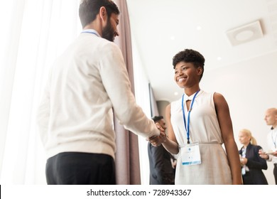 business, partnership and cooperation concept - handshake of people at international conference