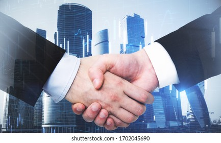 Business partnership with double exposure of handshaking men and abstract financial chart. Occupation and worker concept.