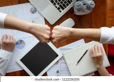 Business partnership giving fist bump to Start up new project. Business and Teamwork of Partnership concept. Corporation meeting in company or industrial work concept. Top view