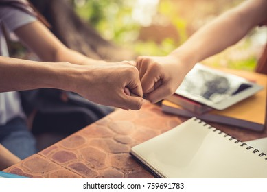 Business partnership giving fist bump to Start up new project. Business and Teamwork of Partnership concept. Corporation meeting in company or industrial work concept.