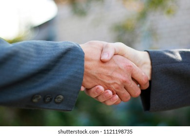 Business partnership handshake concept. Two coworkers handshaking process work