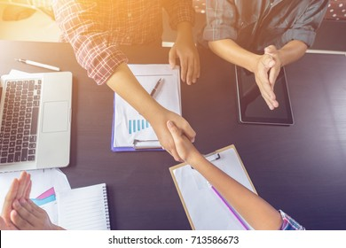 Business partnership marketing meeting concept. Image businessmans handshake. Successful businessmen handshaking after good deal.vintage color, Discussing Together Startup Idea.Working Online Project